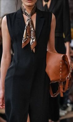 Trussardi, 2014. Elegant tailoring and neck scarf.