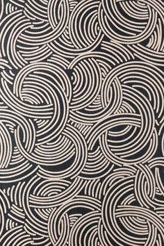 Taken from the Ducharne studio which created designs for some of the most famous couture houses in France from the 1920s to 1960s.  The paper is composed of segmented circles which blend to give a graphic look. Full roll width is 53cm/21