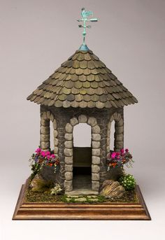 Stone Gazebo with geranium flower boxes by Pepperwood Miniatures