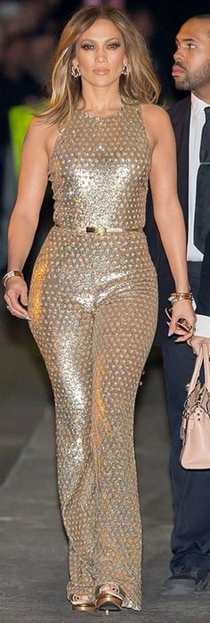 Jennifer Lopez wearing Valentino My Rockstud Mini Top-Handle Tote Bag and Michael Kors Gold Embellished Jumpsuit Sparkly Jumpsuit, Gold Jumpsuit, Embellished Jumpsuit, J Lo Fashion, Star Fashion, Jennifer Lopez News, Metallic Jumpsuits, Vestidos Sexy, Michael Kors Collection
