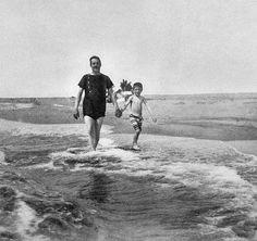 Giacomo Puccini walking on the beach with his son Antonio.