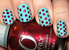 Bright blue nails with red polka dots