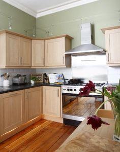Victorian pine floors, recessed under cabinet lighting, track lighting above, white metro tiles, green walls, Moben kitchen