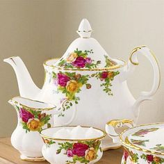 Royal Albert Old Country Roses china my favorite china, love making tea in a lovely teapot...........Thank goodness I still have the teapot set!