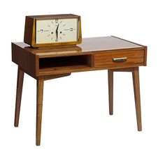 1960s small table with drawer and horologe clockAsmall mahogany and bronzetablewithdrawerfrom a set of furniture made specially for a model apartmentinCheremushkidistrict,Moscow. The clock also dates from the 60s and was made in Mosproekt