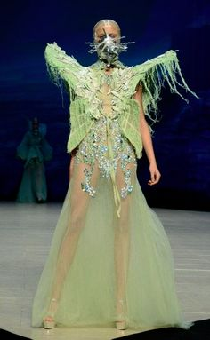 """Amato Couture S/S 2012 - Some man has to be making these """"fashions""""."""