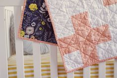 """This listing is for a toddler size quilt [36""""x44""""]. If you would like this quilt in throw size [48""""x64""""], please add the """"throw upgrade"""" to your cart as well.this beautiful, modern quilt has peach plus signs stretching across the quilt top and is quilted with diagonal lines stretching from edge to edge [quilted with coordinating white thread]. soft, cotton batting is sandwiched between high quality fabric. the finished quilt measures 36""""x44"""