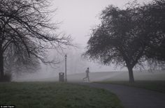 Looking forward: A man goes for a run in Primrose Hill, North London this morning. Warm weather is predicted to move in later today and last...