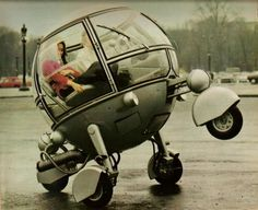 Designed by Jean Pierre Ponthieu. in the 1970s.  The Pussycar Automodule was created as a promotional vehicle.  Described as 'The Car of the Year 2000′, its rear wheel was powered by a 250cc single cylinder engine.