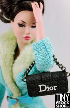 Oh how we covet Dior! Now you can get a Christian Dior Style Promenade Clutch Handbag for Barbie! In a variety of colors. Dior logo and metal chain strap. (rubber, does not open). 1:6 Scale. No longer