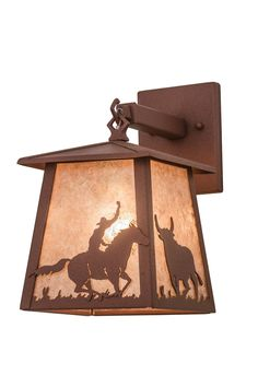 7 Inch W Cowboy & Steer Hanging Wall Sconce - 7 Inch W Cowboy & Steer Hanging Wall SconceA lone cowboy on his trusty horse accents thisWestern inspired four sided pendant shade. The wall sconce is finished in Rust, has Amber mica panels, and handcrafted in the USA by Meyda artisans. Theme: RUSTIC MISSION LODGE ANIMALS SOUTHWEST RECREATION MICA Product Family: Cowboy & Steer Product Type: WALL SCONCES Product Application: ONE LIGHT Color: RUST/SILVER MICA Bulb Type: MED Bulb Quantity: 1 Bulb…