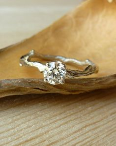 My favourite ?? Like the prongs. Prong Set Diamond Branch Band - Deposit. $500.00, via Etsy.