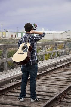 I like the idea of walking on the tracks with the guitar, perhaps a bit of a different execution for me tho!