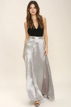 Add a little shine to any special event in the On Holiday Silver Satin Maxi Skirt! Shiny silver satin flows from a tying wrap waist into a full maxi skirt.
