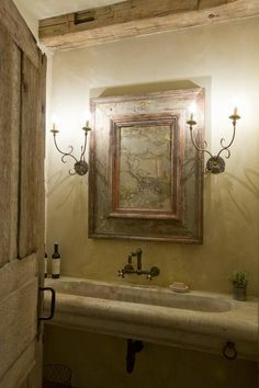 The powder room sink  was originally an old trough used to water livestock.