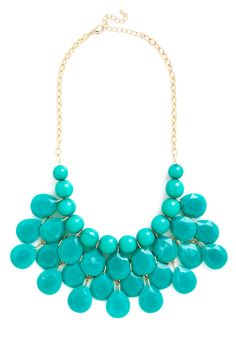 "At the Last Minute Necklace in Teal | ""See you in five,"" your pal says just before you hang up the phone. Reaching for this teal bib necklace, you don't feel rushed to find a standout look - you know all you have to do is rely on the round beads and tiers of teardrop-shaped baubles that hang from the golden chain of this bold piece!"