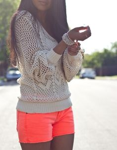 coral shorts & bright knitted sweater