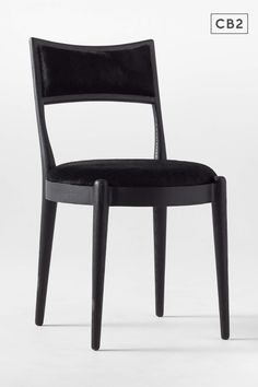 This Brett Beldock-designed dining chair is a total showstopper in all black. Solid red oak with ebonized black finish accentuates subtle curves and rounded edges. Black, genuine hair on hide leather covers the round seat and backrest. Stunning at the dining table but can easily hold its own as an accent chair. Learn more about Brett Beldock on our blog. CB2 exclusive. Red Oak Wood, Professional Upholstery Cleaning, Modern Boho, Leather Cover, Unique Colors, Dining Chairs, Dining Table, Dining Room, Modern Furniture