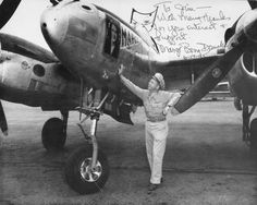 USAAF Major Richard Bong with his P-38 Lightning aircraft 'Marge', date unknown. He died shortly after the war in a crash of the one of the first production jet fighter, a P-80.