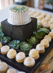 cupcakes and a small cake in place of the traditional wedding cake