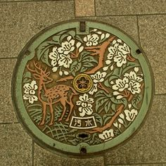 iManhole cover in Nara City, Japan.  Nara is famous for its tame deer.