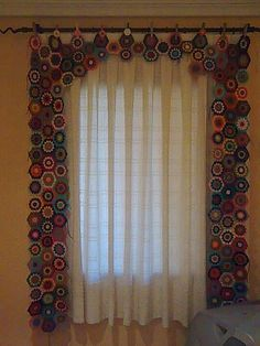 This looks like crocheted circles made into a curtain with self valance.  Super cute !