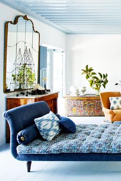 Blue and white eclectic Mediterranean living room chaise via @thouswellblog