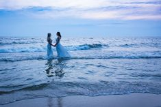 Beautiful beach wedding, blue hour photo of two brides in the water. <3  Taken in Saugatuck Michigan by Lily Angiolini of Miss Lily Photography 2018