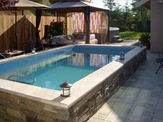 Endless Pool and daybed with cabana for exercise followed by some rest and relaxation.