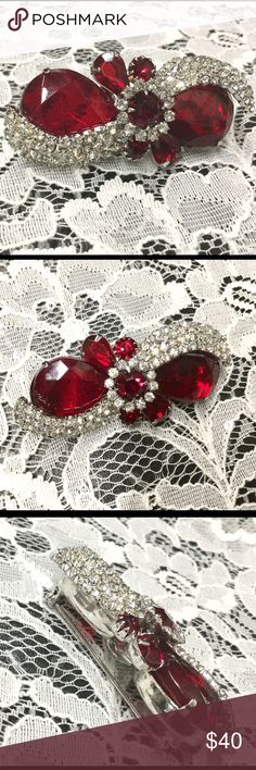 Stunning Red And Clear Rhinestone Bow Brooch Amazing large red faceted prong set rhinestones with two, four rows each, of clear rhinestones. Center accent is a red faceted ruined encircled with a ring of clear rhinestones.  Too sweet!  Silver tone. Vintage Jewelry Brooches