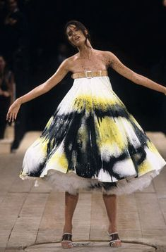 * Alexander McQueen (British, 1969–2010). Dress No. 13, spring/summer 1999. White cotton muslin spray-painted black and yellow with underskirt of white synthetic tulle. Photo Sølve Sundsbø