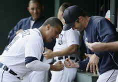 Victor Martinez and Brad Ausmus doing their fist pump.