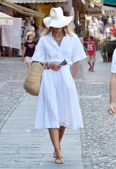 White Hot! Model Elle Macpherson pulled off the all-white look like a rock star in Portofino, Italy . FROM: EXTRA