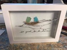 Sea Glass at its most creative! Canvas features two sea glass birds in their nest that restst ion a real twig. So Good To Be Home. Great housewarming gift. The shadow box is white and it is 5X7.You can also choose to have this in a black shadow box. This is made to order, so the sea glass may not be the exact shape as pictured.