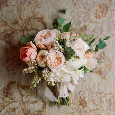 Casual Garden Rose Wedding Bouquet | Wedding Flowers Photos | Brides.com a variety of peach garden roses, birch leaves, Pieris japonica, white hydrangeas, and tiny unripe grape clusters.