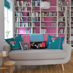 Love that the inside of the shelves are painted to match the living room decor, don't love these colors but love the idea!