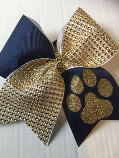A personal favorite from my Etsy shop https://www.etsy.com/listing/515021026/navy-blue-and-gold-rhinestones-cheer-bow