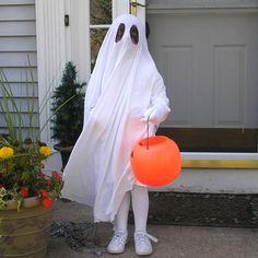 Ghost Costume | Halloween Costumes | Spoonful (Hat is pinned in place underneath to keep costume from slipping. Large eye holes with black makeup on face.)