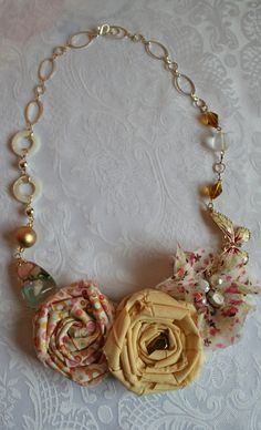 fabric jewelry, I wish I could wear nice necklaces again without fear of my son ripping them from my neck! Jewelry Crafts, Jewelry Art, Handmade Jewelry, Textile Jewelry, Fabric Jewelry, Cloth Flowers, Fabric Flowers, Fabric Flower Necklace, Mixed Media Jewelry