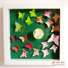 Die Baby-Schmetterlinge in rosa, grün und bissi braun.