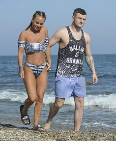 Together again: The Geordie beauty wowed in a skimpy bikini which flaunted her tanned and toned figure as she hit the beach with her on-again beau