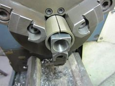 Hold square stock in three jaw chuck.