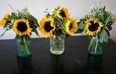 Sunflower aisle arrangements and centerpieces in mason jars.
