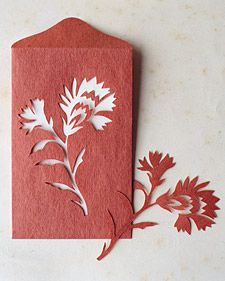 These charming paper-cutout greeting cards and envelopes display flowers of the month.