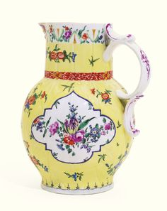 A Worcester yellow- ground cabbage leaf moulded mask jug, circa 1765 the globular leaf moulded body with scroll handle and mask spout, painted with garlands of flowers in purple-edged barbed panels, reserved on a bright yellow ground scattered with indianische Blumen, the rim with enamelled trailing flowers and moulded leaves, restoration to spout