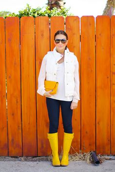 Love, Olia. Yellow rubber boots and a puffer vest