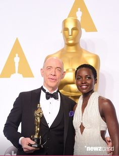 2015 ACADEMY AWARDS ~ Photo: Lupita Nyong'o (2014 Best Supporting Actress winner) and J.K. Simmons in the press room after she presented him with the 2015 Oscar for Best Supporting Actor for WHIPLASH.