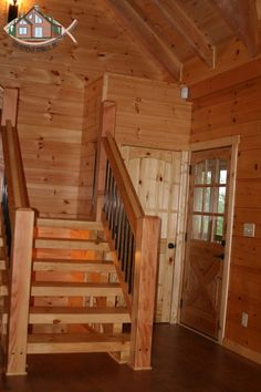 White pine (treads and stringer) and Douglas Fir (handrails) heavy timber stairs. Handrails done with powder coated aluminum balusters. Mirrored stairwell to basement underneath.