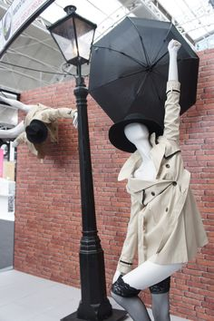 "GDP mannequins, ""Weather Forecast: heavy rain and strong winds to the North"", pinned by Ton van der Veer"