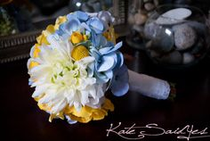 Blue Hydrangeas, Yellow Ranunculus, Billy Buttons, Roses, and Mums